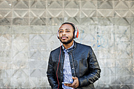 Young man with headphones and smartphone - VABF00971