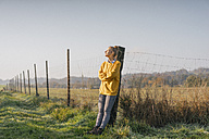 Young woman relaxing on the countryside - KNSF00731