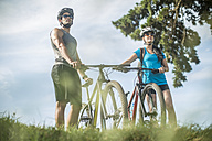 Young couple mountain biking in nature - ZEF11878
