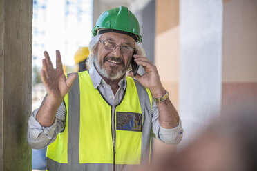 Construction worker on construction site talking on the phone - ZEF11893