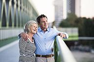 Happy senior couple on a bridge - HAPF01251