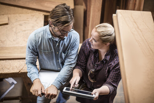 Man and woman working together in woodwork - ZEF11909