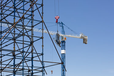 Construction crane and scaffold on construction site - ZEF11960