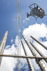 Construction crane moving concrete batch - ZEF11963