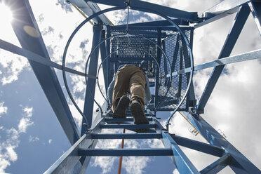 Worker climbing on construction crane, view from below - ZEF11975