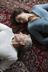 Mature couple lying on carpet - RBF05347