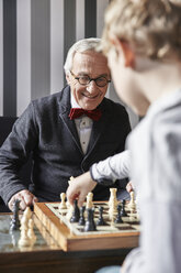 Grandfather and grandson playing chess - RHF01721