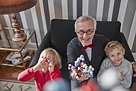 Grandfather and grandchildren with molecular model - RHF01736