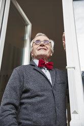 Smiling senior man at the window - RHF01751