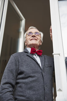 Smiling senior man at the window - RHF01751