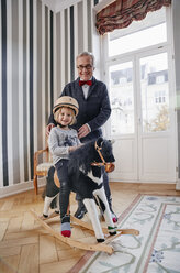 Grandfather and granddaughter on rocking horse - RHF01757