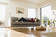 Pregnant woman sleeping on couch - UUF09580