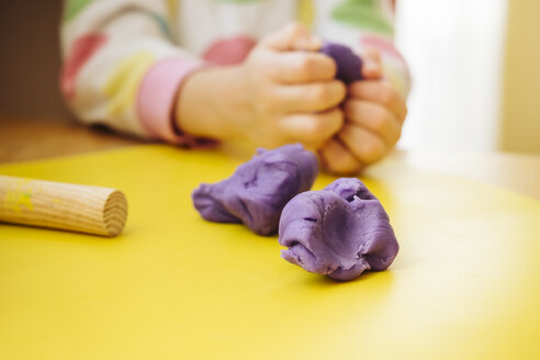 Child's hands kneading modelling clay - KRPF02091