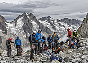 France, Chamonix, Grands Montets, Aiguille d' Argentiere, group of mountaineers preparing - ALRF00748