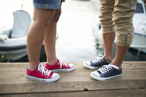 Senior couple wearing sneakers, partial view - HAPF01277