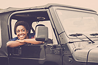 Happy young woman in a car - SIPF01196