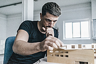 Architect working on architectural model - KNSF00830