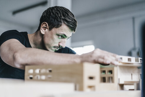 Architect working on architectural model - KNSF00854
