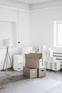 Cardboard boxes in empty loft - KNSF00860