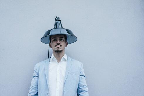 Man wearing lampshade as hat - KNSF00869