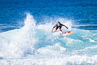 Spain, Tenerife, boy surfing - SIPF01204