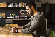 Young man using digital tablet in modern office - TCF05281