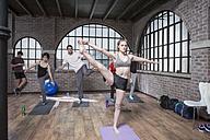 Woman instructing yoga class - ZEF12069