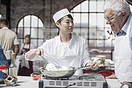 Senior man taking a cooking course - ZEF12105