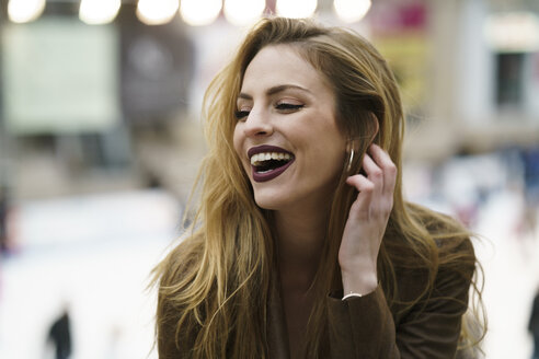 Portrait of laughing blond woman - KKAF00242
