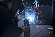 Close-up of two welders at work - ZEF12124