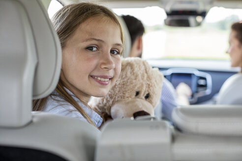 Happy family doing a road trip, daughter looking at camera - WESTF22355