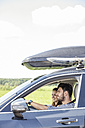 Couple driving car with roof rack - WESTF22409