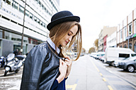 Fashionable young woman wearing hat and leather jacket - VABF00998