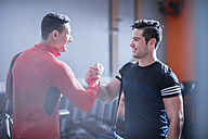 Two young men shaking hands in gym - ZEF12259