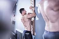 Two young men exercising in gym - ZEF12286
