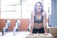 Portrait of happy young woman in gym - ZEF12289