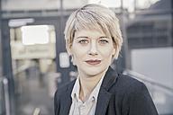 Portrait of blond businesswoman - FMKF03432