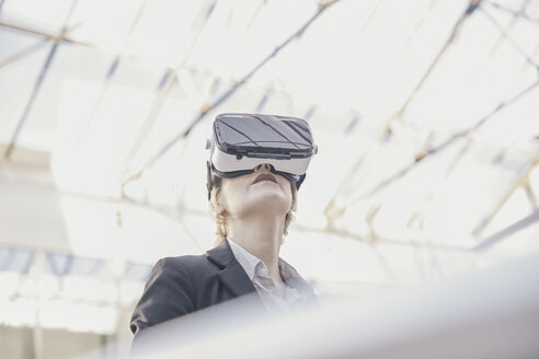 Businesswoman using Virtual Reality Glasses - FMKF03435