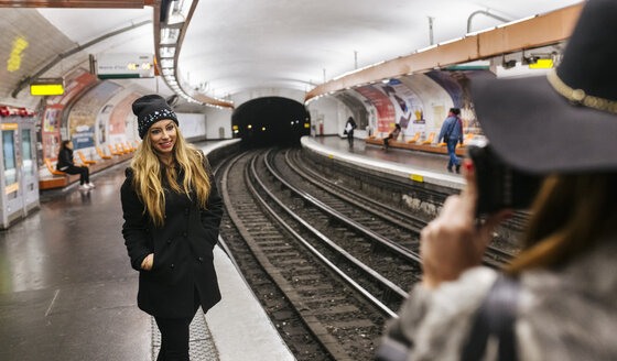 Paris, France, tourists taking picture  at underground station platform - MGO02736