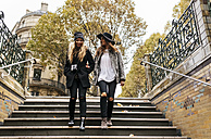 Paris, France, two young women walking downstairs - MGOF02739