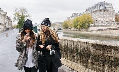 Paris, France, two women strolling near Seine River - MGOF02748