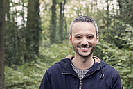 Portrait of smiling man in the woods - DWIF00817