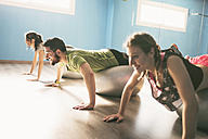 Group of young people training with fitness balls in gym - JASF01451