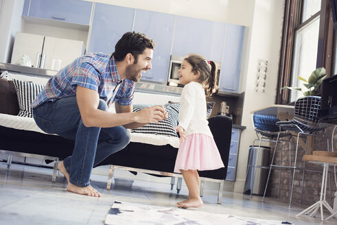 Father and daughter having fun at home - WESTF22423