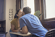 Young couple kissing in kitchen - WESTF22507