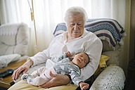Great grandmother taking care of her great granddaughter at home - GEMF01362