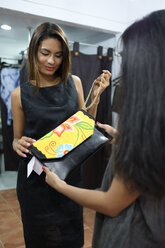Customer shopping in fashion boutique - ABAF02128