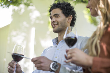 Young man with wine glass making an announcment - ZEF12390