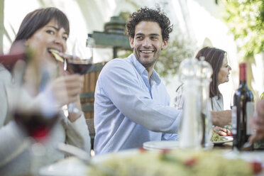Friends and family having lunch in garden - ZEF12396