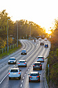 Germany, Stuttgart, Cars on highway at sunset - WDF03856